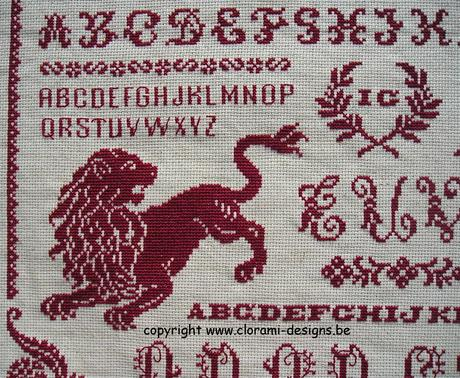 red cross stitch sampler with ancient cross stitch letters