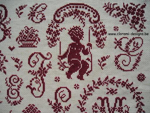 romantic red cross-stitch sampler with elegant ancient sajou letters and cross-stitch flowers