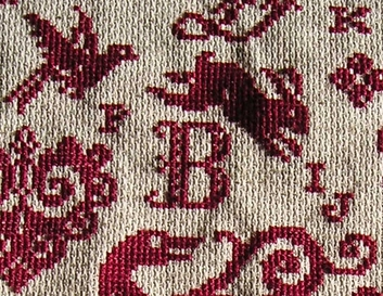elegant cross stitch letters in needlepoint samplers